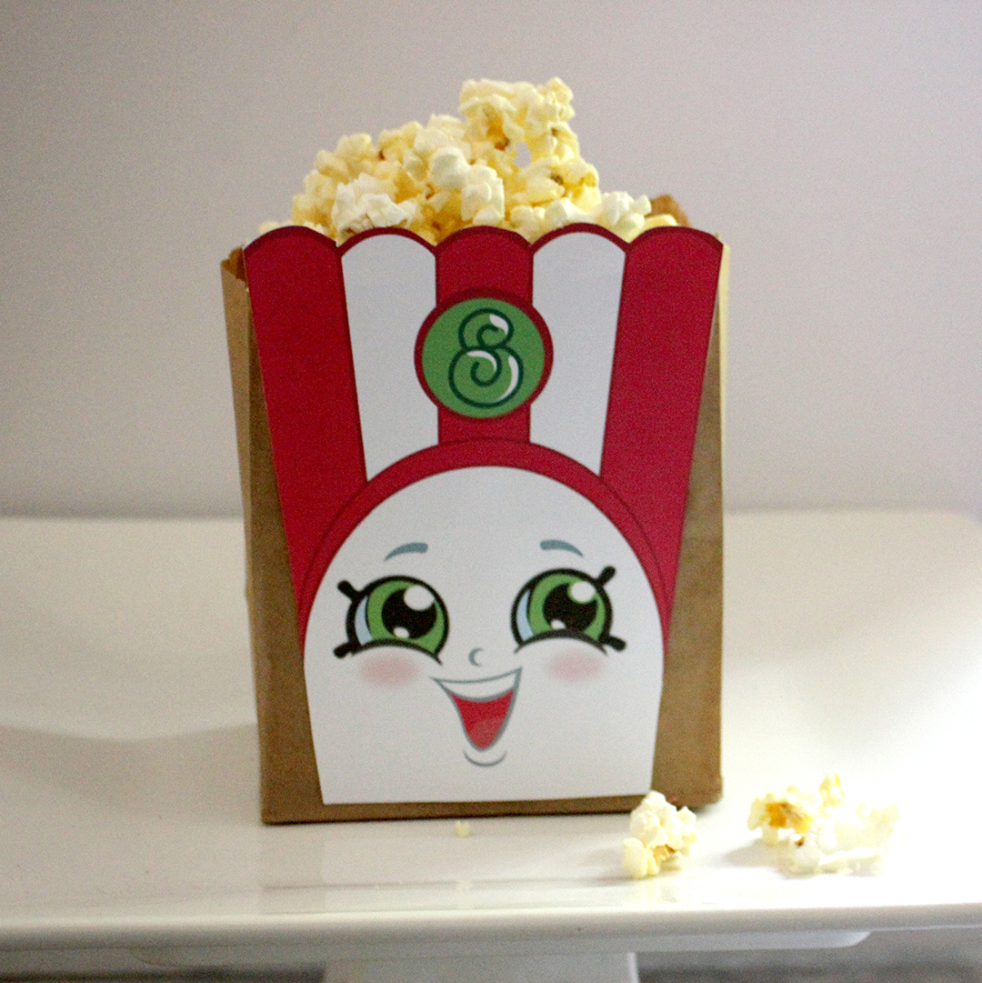 Poppy corn bag filled with fresh popped popcorn.