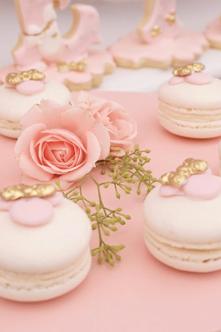 This Disney Macarons: Minnie Mouse birthday party is pink and gold with floral accents and Disney ears. Crazy cute 1st birthday inspiration.