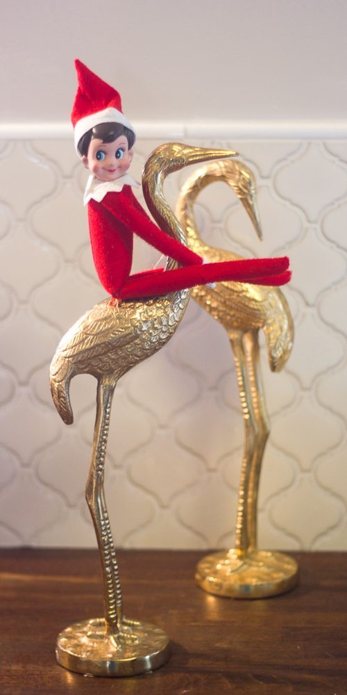 This Elf on the Shelf is riding a flamingo to the North Pole.