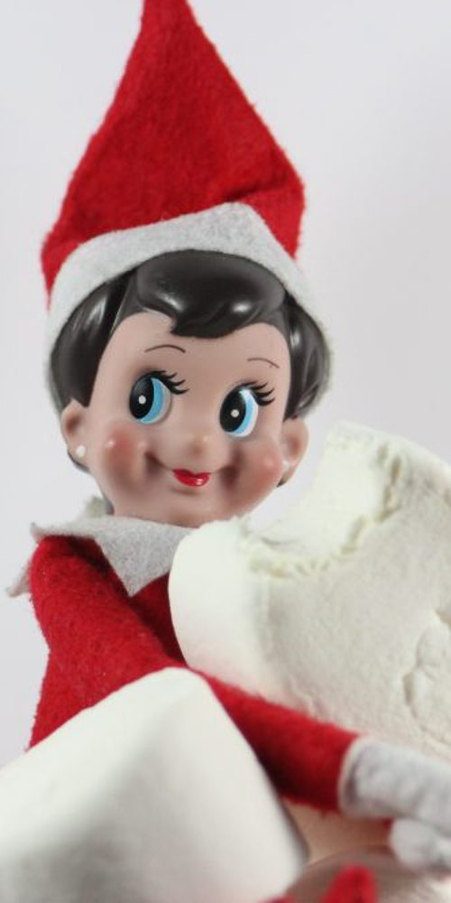 This elf on the shelf is eating a marshmallow. Yum!